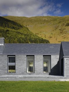 Killowen House by Hall McKnight, a stone twin farm building in the Lough. Stone is understated but looks good in landscape. Contemporary Barn, Contemporary Architecture, Architecture Details, Brick Cladding, Brickwork, Modern Barn House, Rural House, Cottage Plan, Farm Cottage