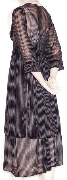 """1914 ... Day Dress ... sheer black and white striped lawn dress with a separate overskirt, a ruffled Valenciennes lace jabot insert and collar, and a front hook and eye closure. ... 14"""" from shoulder to shoulder, a 34"""" chest, 27"""" high waist,and 46"""" from shoulder to front hem. ... from Time Travelers on eBay ... photo 2"""