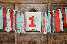 Red and Ice blue Winter ONEderland Wonderland first 1st birthday fabric highchair rag banner, snowflake, party decor ONE 1 cake smash photo by GiddyGumdrops on Etsy https://www.etsy.com/listing/258902965/red-and-ice-blue-winter-onederland