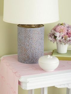 Trendy Upcyled Lamp from an Old Tea Tin~ Dab paint all over the tin. Rub off some of the paint, {allowing a bit of the original finish to show through}. When dry, drill a hole in the center of the lid and another in the back of the tin near the bottom. Install a lamp kit. Done!