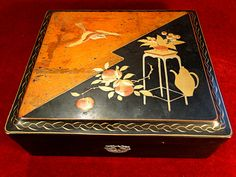 7) Good Meiji period Japanese lacquered box in square form with elaborate gilt decoration depicting a bird, fruit and flowers  Est. £35-£45