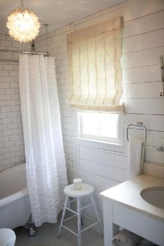 Designer Anisa Darnell layers creamy whites to make this cottage-style bathroom into a cozy retreat.