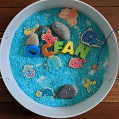 Today's afternoon invitation to play Ocean 🌊 I used the blue colour rice I made yesterday to create this ocean scene for T. I have used our kmart magnetic fishing game. T also added a couple of the Grapat mates cups and did some scooping and pouring 🎣 . . . . . . #funinspiredplay #invitationtoplay #kmartplaytray
