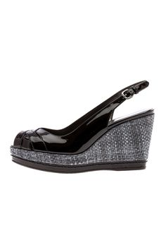 """The sling back wedge is the ultimate classic for the summer months. This glamourous shoe is crafted from black patent leather with a lattice front detail and finished with raffia sides to perfection.  Heel height: 3""""; platform is 1""""  Squint Slingback Wedge by Stuart Weitzman. Shoes - Wedges New Hampshire"""