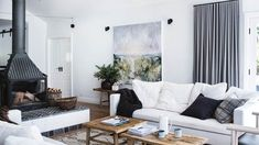 White, light-filled home in the Blue Mountains, NSW Home, Cushions On Sofa, Apartment Rugs, Handmade Home Decor, Cosy Lounge, White Rooms, Living Room White, Rugs In Living Room, Freestanding Fireplace