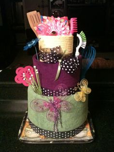 """Wedding shower """"cake"""" with a bath towel, hand towel and dish towel, kitchen tools, dish gloves, craft store decor. Dish Towel Cakes, Kitchen Towel Cakes, Kitchen Towels, Wedding Shower Cakes, Bridal Shower Tea, Cloth Diaper Cakes, Creative Gift Baskets, Towel Crafts, Shower Towel"""