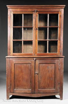 Southern Walnut Bookcase and Cupboard, mid-19th c., Virginia, molded cornice, shaped glazed doors opening to shelf interior, lower cupboard with paneled doors, interior shelf, apron, bracket feet, height 72 in., width 44 1/2 in., depth 16 in