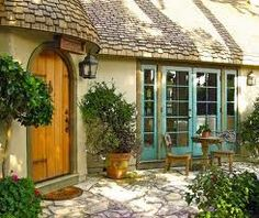 """little cottage homes. """"Love the flagstone, front door, thatch roof and pretty french doors"""""""