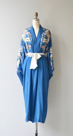 Antique 1920s French blue tissue silk robe with white and tangerine flowers and white chiffon sash. ✂-----Measurements fits like: free size bust: free waist: free length: 53 brand/maker: n/a condition: some wear at the inside of the neckline ✩ layaway is available for this item to ensure a good fit, please read the sizing guide: http://www.etsy.com/shop/DearGolden/policy ✩ visit the shop ✩ http://www.DearGoldenVintage.etsy.com