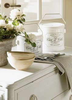 Charming White Kitchen Dresser/Counter with flowers, Canisters, and Table Settings FROM: French Country Home