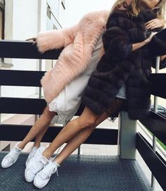 Balance a glamorous faux fur coat with a pair of sneakers