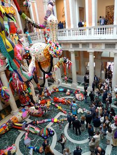 another installation of Contamination by Joana Vasconcelos. yarn, fabric, ornaments, steel cables and awesomesauce.