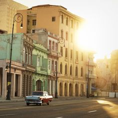 Havana, Cuba. Sunset along The Malecón (officially Avenida de Maceo) and a gorgeous vintage American car. This avenue runs along the water at the mouth of Old Havana.