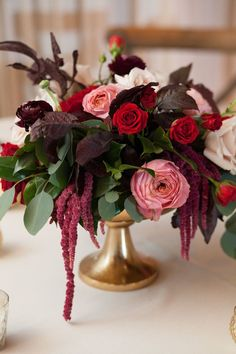 Deep Burgundy and Red Centerpiece with pops of blush in gold urn pedestal // wedding, fall, low and lush, roses