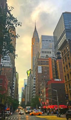 View of the top of the Chrysler building from the street as sun is setting