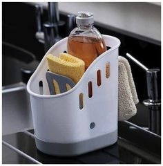 "Your kitchen sink area is probably one of the busiest areas of your home. Why not keep your cleaning products organized and all in one spot. Stores sponges, brushes, soaps, and cloths in our deluxe 'Sink Tidy"" container."