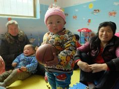 Li Bo's job used to involve reporting unlawful pregnancies to family planning officials. Today, in the remote Wangyuan village in China's mountainous Shaanxi province, he's sat on a playmat helping a toddler build a fort with multi-coloured blocks.
