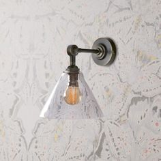 Hazelette pendant in clear glass with Mini elbow wall light fitting in antiqued bronze Wall Lights