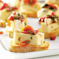 Marinated Cheese Recipe -This special appetizer always makes it to our neighborhood parties and is the first to disappear at the buffet table. It's attractive, delicious—and easy! —Laurie Casper, Coraopolis, Pennsylvania