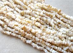 Natural Mother of Pearl Chip Beads, Gemstone Beads, Craft Supplies, Jewelry Making Beads, Shell Beads, Endless Loop, MOP Beads, 35    1 - 35  strand of natural mother of pearl chip beads. These beads have a nice polish and measure 4-7mm in size. You will receive an endless loop of chip beads. They have a creamy white/tannish color. Really lovely beads. Use in your necklace, bracelet or earring designs. Must see to appreciate!   Each strand will be random selected from the group shown…