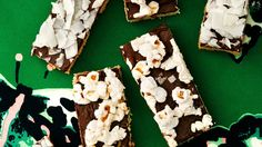 Crunch Bars Use any topping you'd like on these chocolate bars. For starters: crushed candy, toasted chopped nuts, coconut, and popcorn.