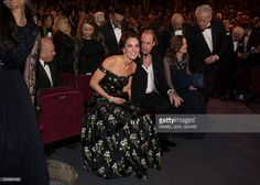 hrhduchesskate: 2017 BAFTA Awards, Royal Albert Hall, February 12, 2017-The Duke and Duchess are seated at the event; behind them are their private secretaries Rebecca Deacon and Miguel Head