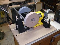 """Sharpening System by Ray Lanham -- Homemade sharpening system based on a Tormek design. Unit is constructed around a wet/dry grinder. Add-ons include an 8"""" honing wheel, a laminated Plexiglas grinding platform, as well as chisel and gouge sharpening jigs. http://www.homemadetools.net/homemade-sharpening-system-2"""