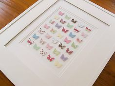 Simple wall art using scrapbooking paper and butterfly punch