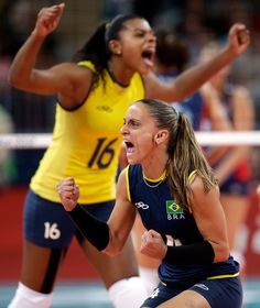 Brazil's Fabiana Oliveira, front and Fernanda Rodrigues react during the women's gold medal volleyball match against the United States.