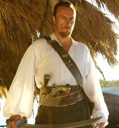 Captain Flint wearing a thin, white shirt that we can see through a bit … and being absolutely loaded with deadly weapons. Movies Costumes, Black Sails Starz, Ayyy Lmao, Pirate Garb, Charles Vane, Golden Age Of Piracy, Captain Flint, Toby Stephens, Pirate Queen