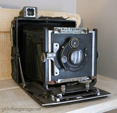 Collections Tour - Come take a look at my antique cameras and turquoise vintage glass, and see what 11 other bloggers love to collect also!  girlinthegarage.net