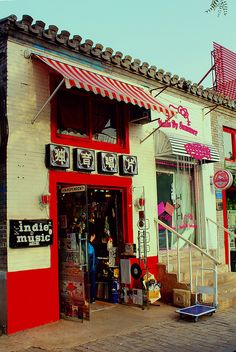 Indie Music seller, Hutong, Beijing, CHINA.  -  (by Cristóbal Alvarado Minic, via Flickr)