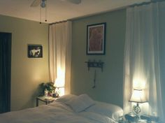 use curtains to frame bed.