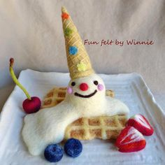 Needle felted Upside down ice cream cone on waffle with