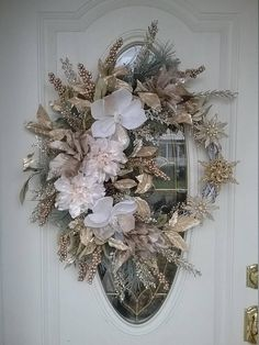 The photos dont do this wreath justice!!! Grapevine wreath base, hand painted white with a dusting of gold glitter. Artificial pine and velvety, iridescent gold leaf and berry sprays, and holographic gold glitter fern fronds. Crisp white and soft platinum gold glitter