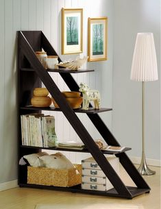 Create a small nook out of a larger room by blocking off a section with a shelf that doubles as a room divider. | 29 Ways To Create The Ultimate Reading Nook