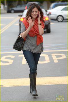 Lucy Hale keeps warm in a cute orange scarf.