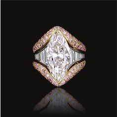 DIAMOND RING, CHANTECLER Estimate: 180,000 - 410,000 CHF LOT SOLD. 200,500 CHF (Hammer Price with Buyer's Premium) Set with a marquise-shaped diamond weighing 8.52 carats, between tapered shoulders of baguette and square-cut diamonds, the mount partly pavé-set with brilliant-cut diamonds of pink tint, mounted in white and yellow gold, signed Chantecler, Italian assay marks, fitted case.