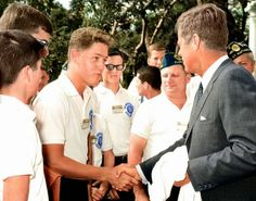 Young Bill Clinton shacking hands with President John F. Kennedy in the Rose Garden of the White House. July 24, 1963.