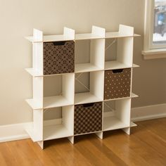 A baby sized Cubby shelf, perfect for the nursery, bedroom, or play room. Mix and match decorative storage bins for extra organization. What a great kids storage idea.