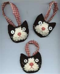 Felt cat ornaments.  Don't know I'll get around to making these buy sure darn cute. Look like our cat, Max!