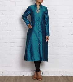 Blue raw silk stunning kundan metal piece with a blue drop highlighting the front opening Kurti.
