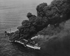 US tanker Pennsylvania Sun burning after being torpedoed by German submarine U-571 in the Gulf of Mexico, 15 Jul 1942. (US Library of Congress)