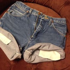 Cut off wrangler denim shorts Never worn! Too small for me  they are cut off wranglers with patch on the back! Tag reads size 28- again impossible more like a size 0! Smoke free home! Wrangler Shorts Jean Shorts