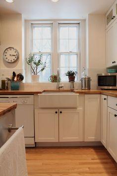 our white farmhouse kitchen with butcher block countertops.