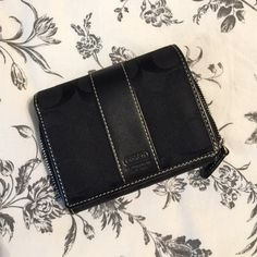 Black Coach Wallet This Coach wallet has been used a handful of times. // small scuff on back near ID pocket (shown in 2nd photo) but it is otherwise still in like new condition // inside is clean, zipper is functional // No holes or stains on fabric // comes from a smoke free environment Bundles welcome Offers welcome ❌NO trades, please. Coach Bags Wallets