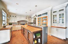 custom kitchen island, white cabinets, two color cabinets, wine cooler, breakfast bar, farm sink, wood countertop, wood hood,