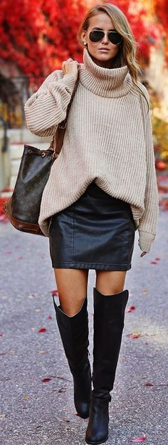 Turtle neck cream sweater, leather skirt and over the knee boots