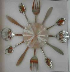 DIY Wall clock for the kitchen. Buy a silver clock, then use a 2-part epoxy to glue dollar store utensils to the back. So cute!