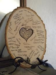 Rustic country wedding guest book on wood. @Heather Creswell Creswell Creswell Fowler  I LOVE THIS IDEA!